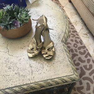 Dark gold three inch heels.